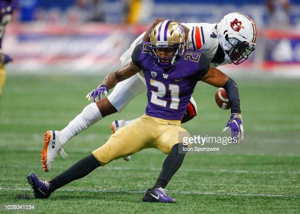 Washington Huskies wide receiver Quinten Pounds has the pass broken up by Auburn Tigers defensive back Noah Igbinoghene during the second half of the...