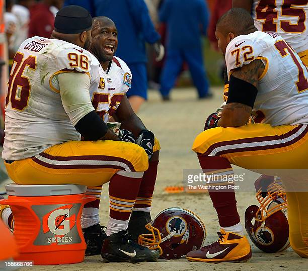 Washington inside linebacker London Fletcher center talks with teammates Barry Cofield left and Stephen Bowen right in the bench area near the end of...