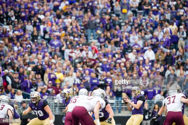 Washington Jake Browning drops back for a pass in the first quarter during a college football game between the Washington Huskies and the Montana...