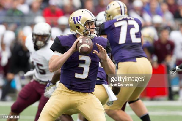 Washington Jake Browning drops back to pass against Montana during a college football game between the Washington Huskies and the Montana Grizzlies...