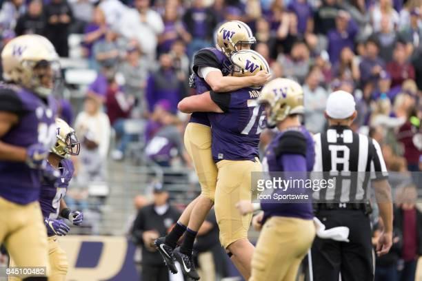 Washington Jake Browning leaps into the arms of Washington Trey Adams during a college football game between the Washington Huskies and the Montana...