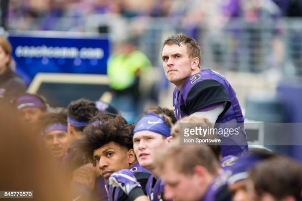 Washington Jake Browning looks up at the scoreboard on the sidelines during a college football game between the Washington Huskies and the Montana...