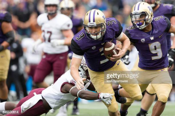 Washington Jake Browning runs through a Montana defender during a college football game between the Washington Huskies and the Montana Grizzlies on...