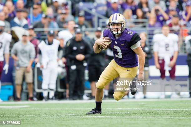 Washington Jake Browning scrambles for a big gain during a college football game between the Washington Huskies and the Montana Grizzlies on...