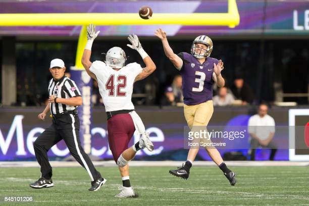 Washington Jake Browning throws a pass over Montana Josh Buss during a college football game between the Washington Huskies and the Montana Grizzlies...