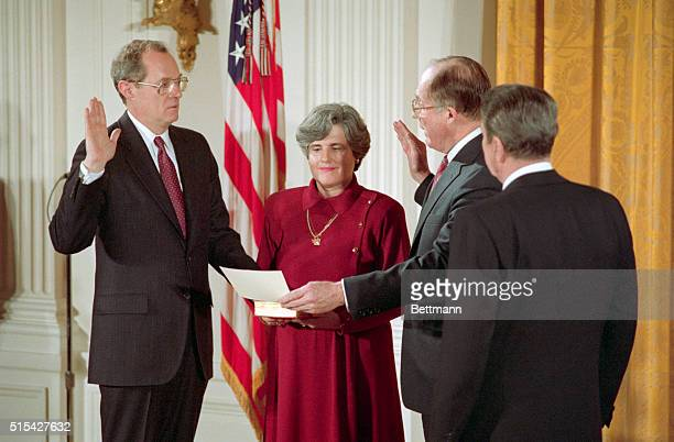 Judge Anthony Kennedy is given the constitutional oath required of all federal employees by Chief Justice William Rehnquist during a White House...