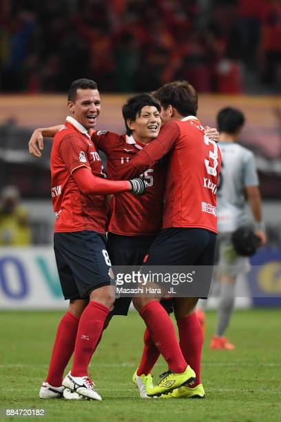 Washington, Kazuya Miyahara and Kazuki Kushibiki of Nagoya Grampus celebrate their promotion to the J1 after the scoreless draw in the J.League J1...