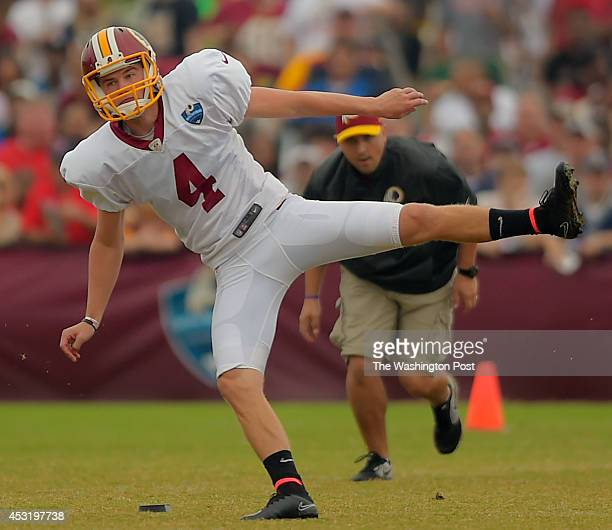 Washington kicker Zach Hocker follows through after kicking off the the Patriots during day 12 of the Washington Redskins training camp practicing...