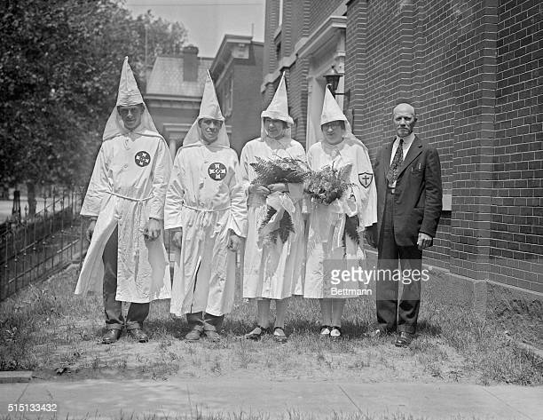 Klan Wedding Precedes Great Parade In Capital Above are shown the members of the wedding party who attended the wedding of Miss Mildred House to...