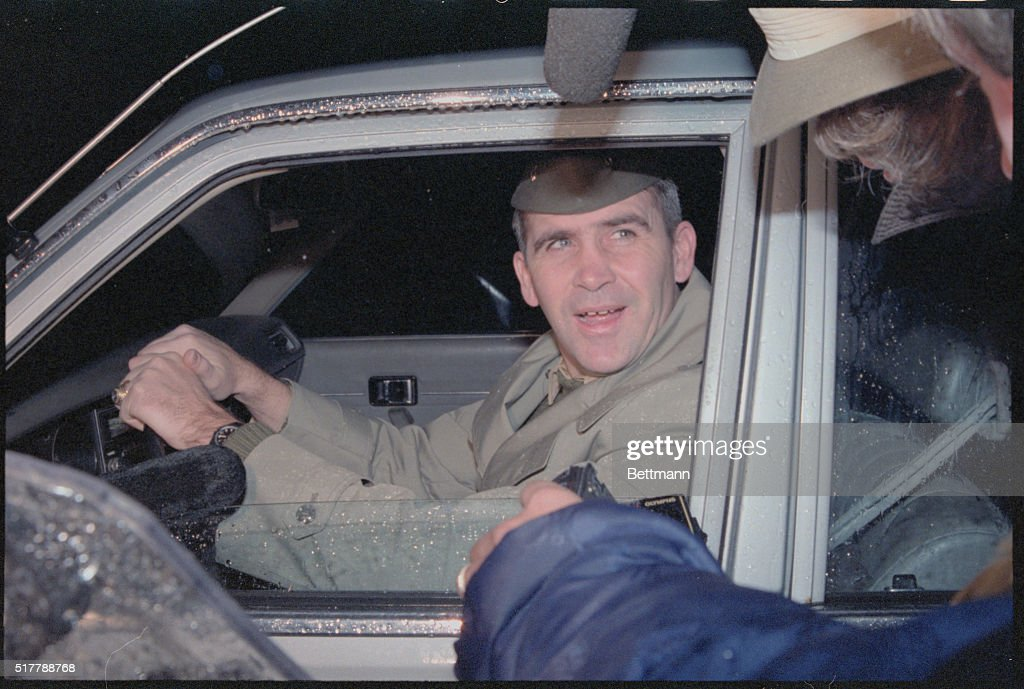 Lieutenant Colonel Oliver North Speaking to Reporters from Limousine : News Photo