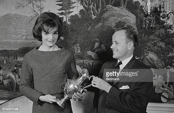 Mrs Jacqueline Kennedy today barely escaped the weight of feminine embarrassmentappearing in a dress identical to that of one of her guests She...