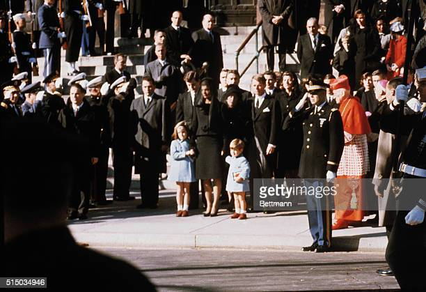 Mrs Kennedy her two children and other members of the Kennedy family watch as the body of her late husband is placed on the caisson for procession to...