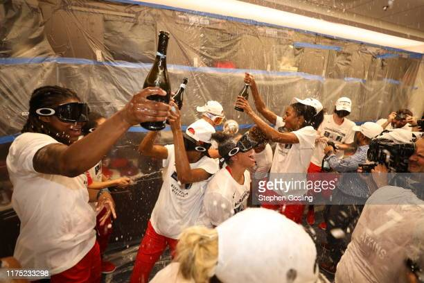 Washington Mystics celebrates in the locker room after winning the 2019 WNBA Finals against the Connecticut Sun during Game Five of the 2019 WNBA...