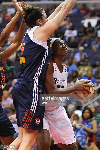 Washington Mystics forward DeMya Walker looks for room to shoot against Connecticut Sun forward Kelsey Griffin and the Sun defense during the fourth...