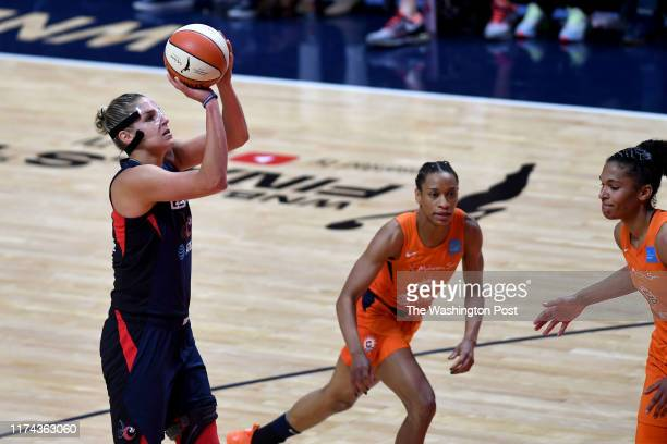 Washington Mystics forward Elena Delle Donne shoots in the second half against the Connecticut Sun despite a herniated disc in her back at Mohegan...