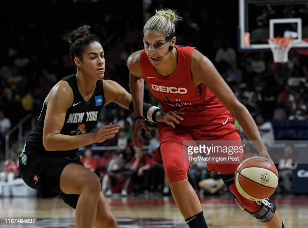 Washington Mystics forward Elena Delle Donne tries to runs her way past New York Liberty guard Kia Nurse during the second half of the game between...