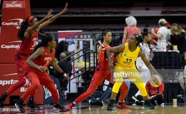 Washington Mystics forward LaToya Sanders guard Ariel Atkins and guard Natasha Cloud gang up on Los Angeles Sparks guard Chelsea Gray during a WNBA...
