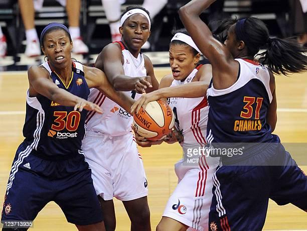 Washington Mystics forward Marissa Coleman battles for a rebound with Connecticut Sun forward Jessica Moore and Sun center Tina Charles as Mystics...