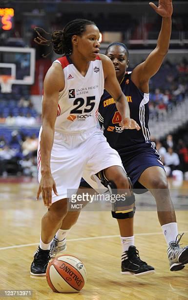 Washington Mystics forward Monique Currie dribbles against Connecticut Sun guard Danielle McCray during the fourth quarter at the Verizon Center in...