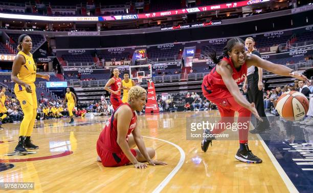 Washington Mystics forward Tianna Hawkins watches as guard Ariel Atkins tries to keep the ball inbounds during a WNBA game between the Washington...