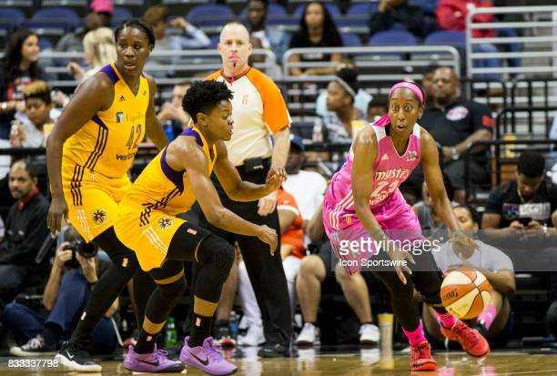 Washington Mystics guard Allison Hightower dribbles away from Los Angeles Sparks guard Alana Beard during a WNBA game between the Washington Mystics...