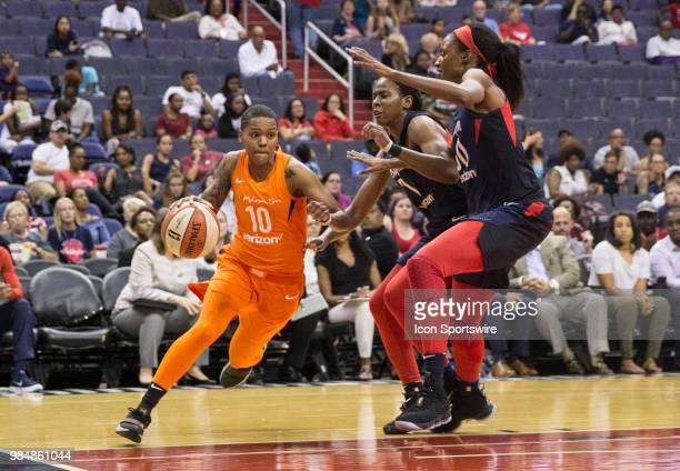 Washington Mystics guard Ariel Atkins and forward LaToya Sanders close in on Connecticut Sun guard Courtney Williams during a WNBA game between the...