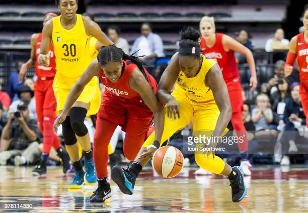 Washington Mystics guard Ariel Atkins and Los Angeles Sparks guard Chelsea Gray reach out for a loose ball during a WNBA game between the Washington...