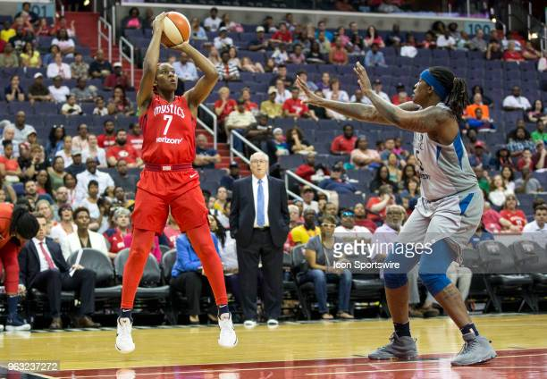 Washington Mystics guard Ariel Atkins goes for a shot over Minnesota Lynx forward Lynetta Kizer during a WNBA game between the Washington Mystics and...
