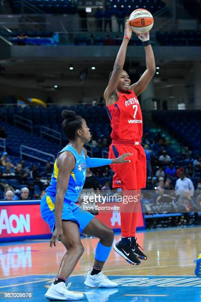 Washington Mystics guard Ariel Atkins passes the ball against Chicago Sky guard Diamond DeShields on June 22 2018 at the Wintrust Arena in Chicago...