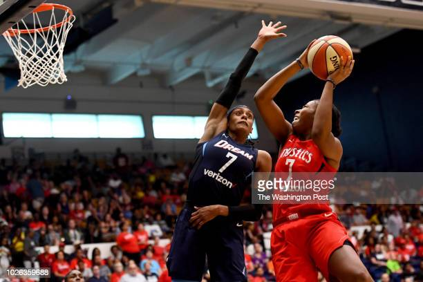 Washington Mystics guard Ariel Atkins shoots for two of her 19 points over Atlanta Dream guard Brittney Sykes in the second half of game 4 of the...