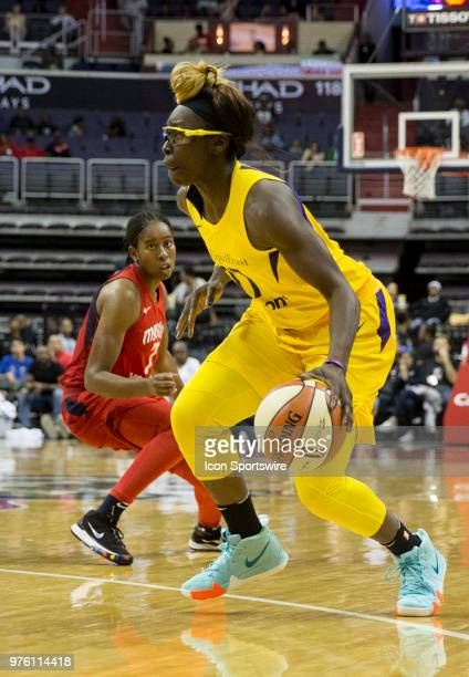 Washington Mystics guard Ariel Atkins turns to watch Los Angeles Sparks forward Essence Carson during a WNBA game between the Washington Mystics and...