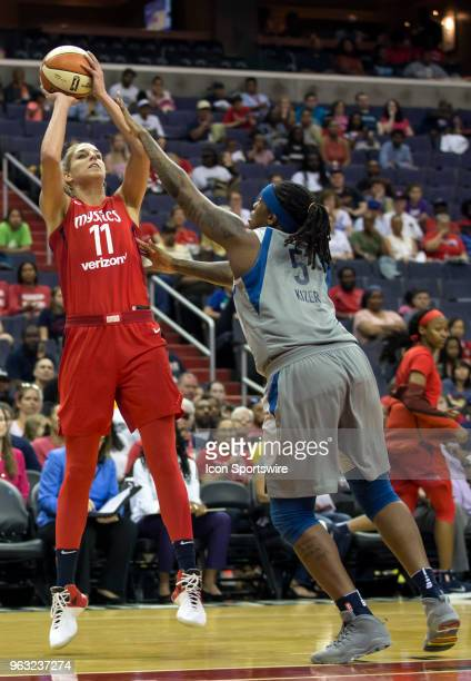 Washington Mystics guard Elena Delle Donne shoots over Minnesota Lynx forward Lynetta Kizer during a WNBA game between the Washington Mystics and the...