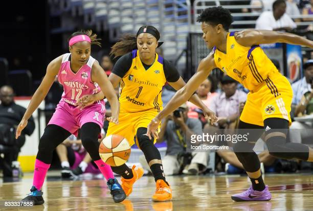 Washington Mystics guard Ivory Latta and Los Angeles Sparks guard Odyssey Sims and guard Alana Beard go after a loose ball during a WNBA game between...