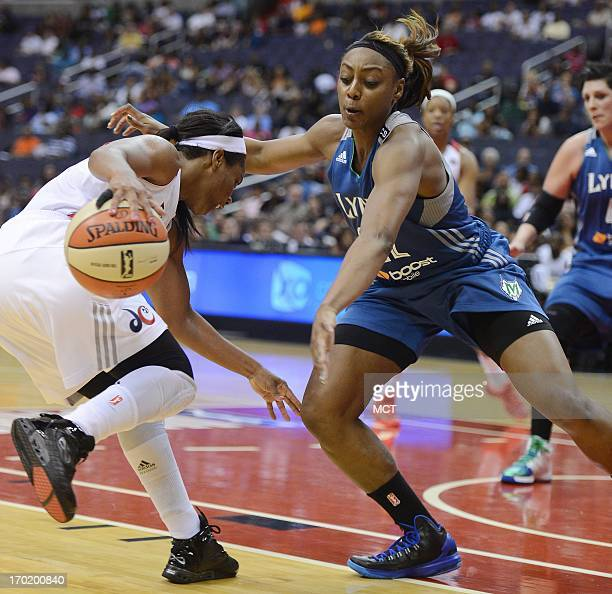 Washington Mystics guard Ivory Latta left attempts to drive against Minnesota Lynx guard Monica Wright in the fourth quarter at the Verizon Center in...