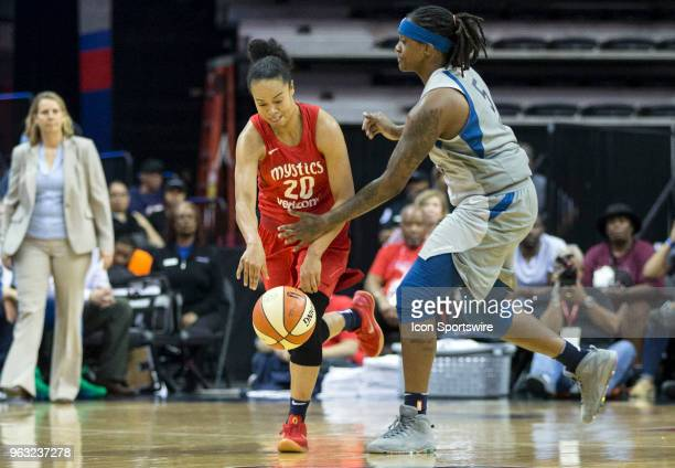 Washington Mystics guard Kristi Toliver dribbles past Minnesota Lynx forward Lynetta Kizer during a WNBA game between the Washington Mystics and the...