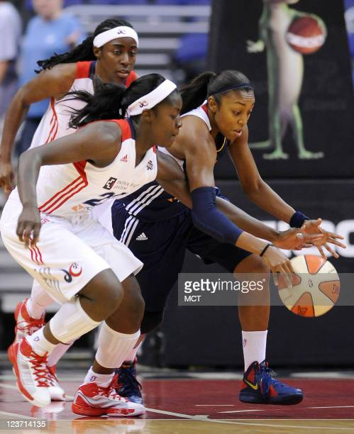 Washington Mystics guard Matee Ajavon left battles for the ball with Connecticut Sun guard Allison Hightower during the first quarter at the Verizon...