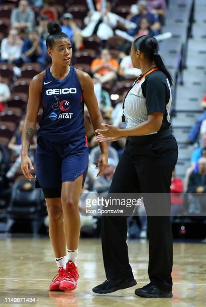 Washington Mystics guard Natasha Cloud speaks with referee Janetta Graham during the WNBA game between Washington Mystics and Connecticut Sun on June...
