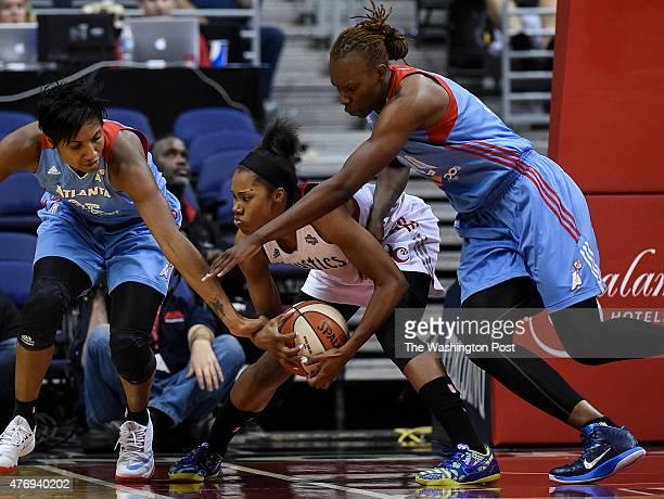Washington Mystics guard Tayler Hill grabs the loose rebound in between Atlanta Dream guard Angel McCoughtry left and Atlanta Dream forward Sancho...