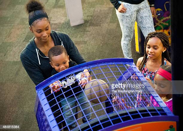 Washington Mystics guard Tayler Hill helps her son Maurice Lighty shoot hoops at Chuck E Cheese's August 18 2015 in Edina MN Since she's based in DC...
