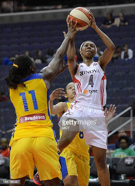Washington Mystics guard Tayler Hill takes the ball up for a basket against Brazil National Team forward Clarissa dos Santos in the fourth quarter of...