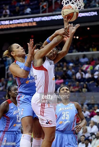 Washington Mystics guard Tierra RuffinPratt gets fouled by Atlanta Dream forward Erika de Souza left as she puts up a shot in the fourth quarter of...