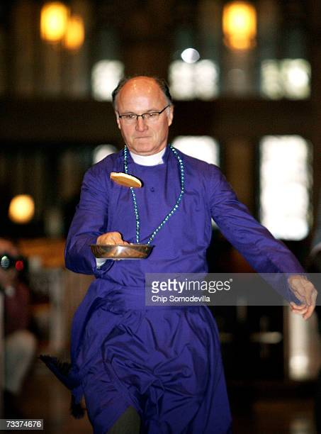 Washington National Cathedral Reverend Canon Howard Anderson flips a pancake while racing up and down the National Cathedral's aisle during the...