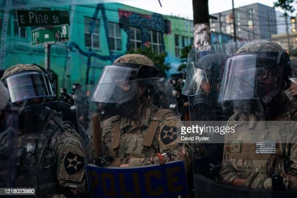 Washington National Guard personnel face off with demonstrators near the Seattle Police Departments East Precinct on June 6, 2020 in Seattle,...