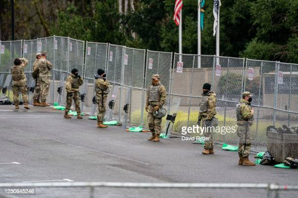 Washington National Guard personnel keep watch in front of the Washington State Capitol on January 17, 2021 in Olympia, Washington. Supporters of...