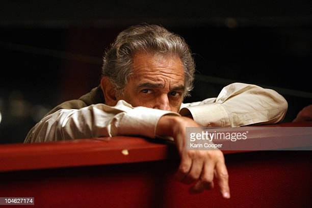 Washington National Opera director Placido Domingo takes a break from conducting during a company rehearsal of Madama Butterfly directed by Marius...