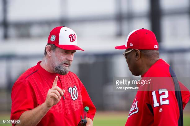 Washington National Third Base Coach Bob Henley speaks with Washington National Manager Dusty Baker during a Washington Nationals spring training...