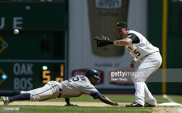 Washington Nationals Alfonso Soriano dives back to first base beating the tag from Pittsburgh Pirates Sean Casey during action at PNC Park in...
