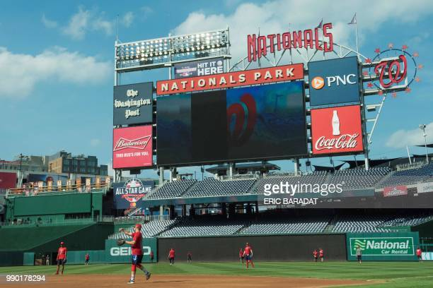Washington Nationals baseball players practice before a game at the Nationals Park on May 21 2018 in Washington DC On a searing hot summer's day in...