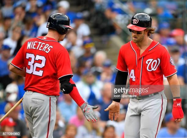Washington Nationals catcher Matt Wieters and Washington Nationals right fielder Bryce Harper celebrate the run during the game between the...