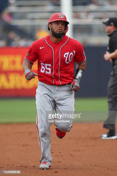 Washington Nationals catcher Raudy Read rounds the bases after hitting a home run during the MLB Spring Training game between the Washington...